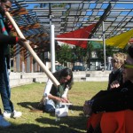Pop up learning tour. The Block, Redfern. Alfred playing the Yidaki- Lily, Orlan & Meredith